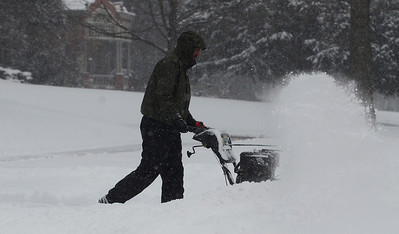 Erica Miller @togianphotog - The Saratogian:     Garrett Trerise snow blows property on North Broadway, owner of Innovative Plant Design, on Wednesday morning, February 5th, 2014, the beginning of the snow storm hitting the North Eastern area. Snow will continue to fall till early evening.