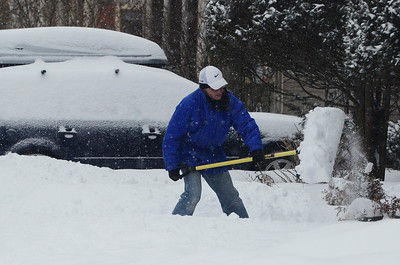 Erica Miller @togianphotog - The Saratogian:     Ludlow resident Robb Blake shovels his sidewalks on Wednesday morning, February 5th, 2014, the beginning of the snow storm hitting the North Eastern area. Snow will continue to fall till early evening.