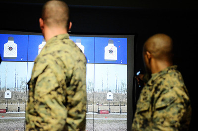 Erica Miller @togianphotog - The Saratogian:     The long day of flying traveling from Saratoga Springs NY to Parris Island, SC, came to and end as we arrived at the Marines Corps Recruit Depot on Tuesday, February 11th, 2014.  Our first full day at Parris Island occurred Wednesday. Marines in the combat pistol program practiced with stimulated beretta 92 9mm's, varying ages. We, the Recruit Station based from Albany and a group from Pittsburg, traveled on two separate busses to enjoy a nice buffet meal at the station.