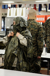 Erica Miller @togianphotog - The Saratogian:     The long day of flying traveling from Saratoga Springs NY to Parris Island, SC, came to and end as we arrived at the Marines Corps Recruit Depot on Tuesday, February 11th, 2014.  Our first full day at Parris Island occurred Wednesday. At the chow, educators were able to enjoy a boxed lunch with some fellow recruits as recruit Andriana Canchola from Kinsburg CA slipped over her pancho after chow.. We, the Recruit Station based from Albany and a group from Pittsburg, traveled on two separate busses to enjoy a nice buffet meal at the station.