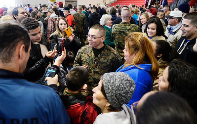 Erica Miller @togianphotog - The Saratogian:     One Parris Island recruits gathered in this large gymnasium where they were able to see their parents for the first time  since they left for recruitment  on Thursday morning, Feb. 13th, 2014. The parents and family ran to their child hugging and crying in tears of joy, taking photographs and videos.