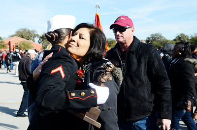 Erica Miller @togianphotog - The Saratogian:     In Parris Island at the Recruit Training Regiment Marine Corps Recruit Depot,  on graduation day on Friday  February 14th, 2014. Saratoga recruit Company Honor Grad Justine Woodend is greeted by her mother and father after graduating from the Marines.