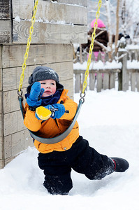 Erica Miller @togianphotog - The Saratogian:  After a evening of snow fall the students at the Waldorf School on Lake Ave enjoyed playing in the snow. Logan Sinclair swung on a swing on their play-set bundled up with snow gear.
