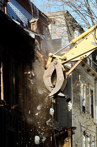 Erica Miller @togianphotog - The Saratogian     Demolition at 66 Franklin Street began Thursday, a long debate in Saratoga Springs for many years. Cristo Demolition, from Albany, began work around noon in the city. The company said they had to wait 14 days till they could began. The state Supreme Court Appellate Division upheld a lower court decision to allow the demolition on October 24th. Joseph Boff is the owner of the building who resides in Florida. Demolition was stopped mid-afternoon due to the need for a larger excavating machine.	SAR-l-66FranklinDEMO9
