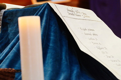 Erica Miller @togianphotog - The Saratogian:   On Sunday April 6th, 2014, the Saratoga County District Attorney's Office held the 15ht Annual Candelight Vigil for Victims of Crime at the Presbyterian-New England Congregational Church in Saratoga Springs. A scroll of victimes of 468 names.