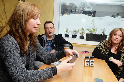 Erica Miller @togianphotog - The Saratogian: Nestled in the back kitchen of Zest, in Ballston Spa on Science Street, CEO and Salt Chef Kerri Tanner (right) Robin Morgan, Chief Marketer, and beside her husband CFO James Morgan with one of their delicious Brew Salts they create. The business is new engaging people to put organic flavored beer salts in their drinks, or even desserts.