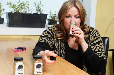 Erica Miller @togianphotog - The Saratogian: Nestled in the back kitchen of Zest, in Ballston Spa on Science Street, CEO and Salt Chef Kerri Tanner smells one of their delicious Brew Salts they create. The business is new engaging people to put organic flavored beer salts in their drinks, or even desserts.