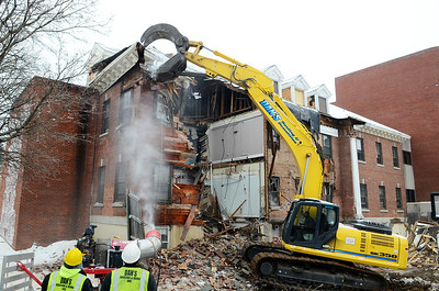 Erica Miller @togianphotog - The Saratogian:  Demolition began on Friday, March 14th, 2014, at the Saratoga Hospital by Dan's Hauling and Demolition under the management of AOW Associates Inc. based out of Albany. Dan Wolfe took down the old mental unit piece by piece with a crew.