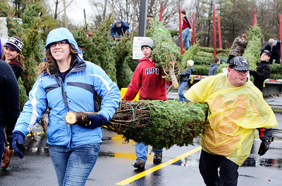 Erica Miller @togianphotog - The Saratogian.   On Wednesday morning, the day before Thanksgiving 11/27/13, over 720 Christmas trees from Vermont arrived at Curtis Lumber for the annual Rotary tree sale. Waiting in the cold rain, bundles up in a shed waited over 60 volunteers. Joining together with Ballston Spa Rotary Club were Saratoga Bridges, Boy scouts from Troop 1, 2 and 246, Ballston Spa HS Interact Club and teachers, Ballston Spa Lions Club, Ballston Spa Football teammates, Twin Bridges and Mechanicville's Rotary Club, family friends and other volunteers.     SAR-l-RotaryTREES13