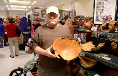 Ed Burke - The Saratogian 11/30/13 Woodworker Ken Gadway of Morrisonville displays a turned bowl at his booth Saturday at the annual craft fair at the City Center to benefit the Saratoga Center for the Family.