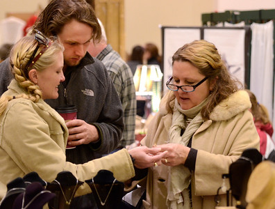 Ed Burke - The Saratogian 11/30/13 Family friend Brandon Gouffon looks on as Mary Lou Wait of Saratoga Springs and daughter Jennifer Wait of Virginia admire handmade jewelry  Saturday at the annual craft fair at the City Center to benefit the Saratoga Center for the Family.