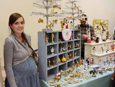 Ed Burke - The Saratogian 11/30/13 Waiting for the birth of their first child, crafter Crystal Hanehan Sloane and her husband Ben Sloane of Schuylerville work Saturday at their booth at the annual craft fair at the City Center to benefit the Saratoga Center for the Family. Their business, Vintage by Crystal, sells spun cotton ornaments made by Crystal based on German artisan techniwues from the late 1800s.