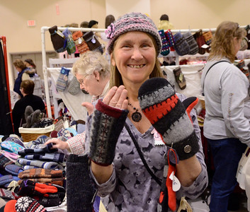 Ed Burke - The Saratogian 11/30/13 Beverly Carroll of Clifton Park displays mittens she makes from recycled sweaters at her booth Saturday at the annual craft fair at the City Center to benefit the Saratoga Center for the Family.