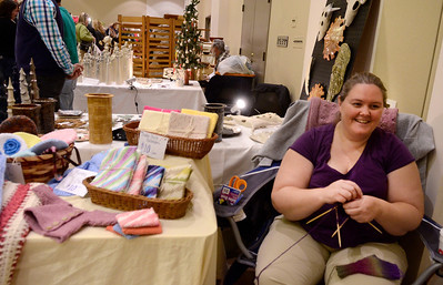 Ed Burke - The Saratogian 11/30/13 Katie Otto od Ballston Spa knits fingerless mittens at her booth Saturday at the annual craft fair at the City Center to benefit the Saratoga Center for the Family.