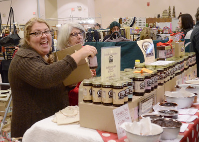 Ed Burke - The Saratogian 11/30/13 With smiles and samples given out free, Katie Camarro stocks her Sundae's Best Hot Fudge Sauce  at her booth Saturday at the annual craft fair at the City Center to benefit the Saratoga Center for the Family.