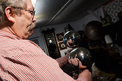 Erica Miller @togianphotog - The Saratogian:  On Friday April 25th, 2014, a the Washington County Fairgrounds, Mike Smith owner of Cherry Tree Auctions holds two gazing balls (or reflection balls). This Saturday there will be a fine estate auction and collection from Bob Schere, of Glens Falls, at 5 p.m.