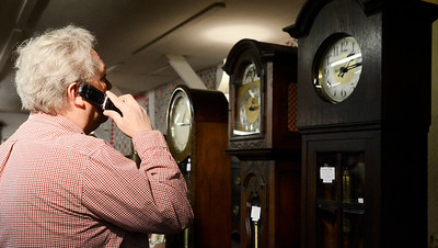 Erica Miller @togianphotog - The Saratogian:  On Friday April 25th, 2014, a the Washington County Fairgrounds, Mike Smith owner of Cherry Tree Auctions on the phone with a customer regarding clocks. This Saturday there will be a fine estate auction and collection from Bob Schere, of Glens Falls, at 5 p.m.