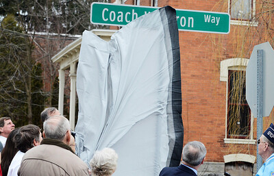Erica Miller @togianphotog - The Saratogian:  On Friday April 4th, 2014, the city of Saratoga Springs dedicated the late Ray Waldron with a street sign replacing Pleasant Street to Coach Waldron Way. Waldron's son Joe Waldron revealed the new sign, Coach Waldron Way.