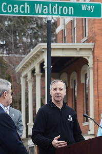 Erica Miller @togianphotog - The Saratogian:  On Friday April 4th, 2014, the city of Saratoga Springs dedicated the late Ray Waldron with a street sign replacing Pleasant Street to Coach Waldron Way. Waldron's son Joe Waldron revealed the new sign, Coach Waldron Way, and spoke briefly after.