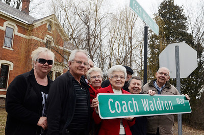 Erica Miller @togianphotog - The Saratogian:  On Friday April 4th, 2014, the city of Saratoga Springs dedicated the late Ray Waldron with a street sign replacing Pleasant Street to Coach Waldron Way. Family members, four brothers and 1 sister (with in-laws), posed for a photograph after the presentation.