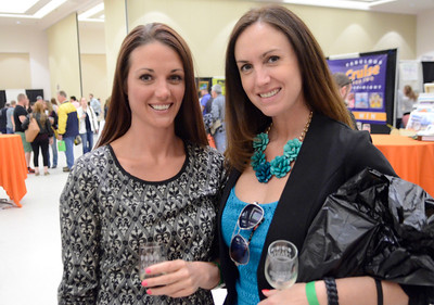 Ed Burke - The Saratogian 04/19/14 Jessica Stanislowsky, left, and Jamie Elder of Saratoga Springs attend the Taste of Upstate Wine, Food and Music Festival Saturday at the Saratoga Springs City Center.