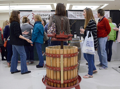 Ed Burke - The Saratogian 04/19/14 A fruit press and other wine making equipment were on display at the Taste of Upstate Wine, Food and Music Festival Saturday at the Saratoga Springs City Center.