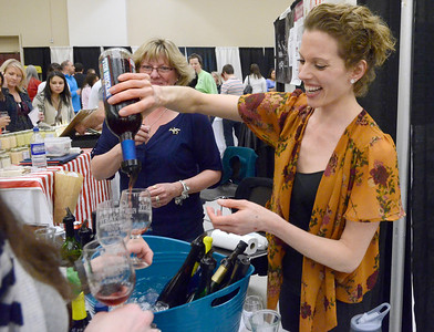 Ed Burke - The Saratogian 04/19/14 Lindsey Lehr, local manager at Swedish Hill Winery on Broadway pours a customer a sample at the Taste of Upstate Wine, Food and Music Festival Saturday at the Saratoga Springs City Center.
