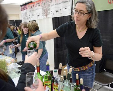 Ed Burke - The Saratogian 04/19/14 Margo Johnston of Johnston's Winery in Galway pours a sample of their product at the Taste of Upstate Wine, Food and Music Festival Saturday at the Saratoga Springs City Center.