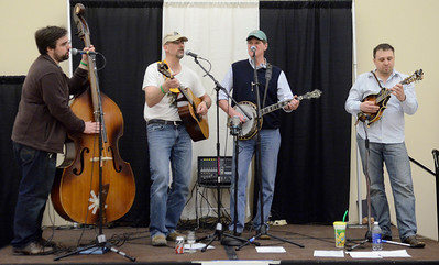 "Ed Burke - The Saratogian 04/19/14 Upstate band Flood Road plays their version of ""acoustic folkgrass"" at the Taste of Upstate Wine, Food and Music Festival Saturday at the Saratoga Springs City Center."