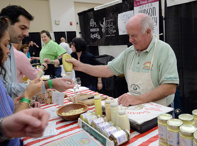 Ed Burke - The Saratogian 04/19/14 Bill Higgins of Saratoga Garlic gives out samples of their dips at the Taste of Upstate Wine, Food and Music Festival Saturday at the Saratoga Springs City Center.