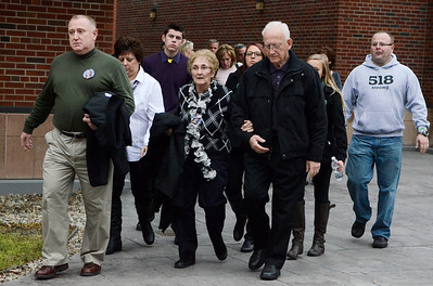 Erica Miller @togianphotog - The Saratogian.    Friends and family members leave court after the Dennis Drue hearing at Saratoga County Court. Drue was sentenced to 5-15 year in state prison after killing two Shenendehowa students and seriously injuring two others a year from Dec 1. 12/5/13   SAR-l-DrueSentence9