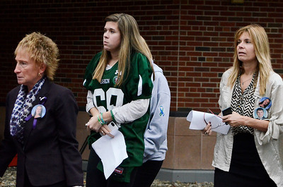 Erica Miller @togianphotog - The Saratogian.    Bailey Wind, wearing her late boyfriend Chris Stewarts jersey, leaves court after the Dennis Drue hearing at Saratoga County Court. Drue was sentenced to 5-15 year in state prison after killing two Shenendehowa students and seriously injuring two others a year from Dec 1. 12/5/13   SAR-l-DrueSentence8