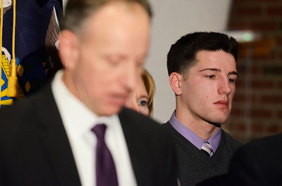 Erica Miller @togianphotog - The Saratogian.    Matt Hardy stands holding back tears after the Dennis Drue hearing at Saratoga County Court during a press conference. Drue was sentenced to 5-15 year in state prison after killing two Shenendehowa students and seriously injuring two others a year from Dec 1. 12/5/13   SAR-l-DrueSentence14