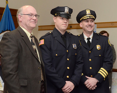 Ed Burke - The Saratogian 03/18/14 New Saratoga Springs police officer Greg Lewis stands with Chief Greg Veitch and Public Safety Commissioner Chris Mathiesen after being sworn-in at Tuesday's city council meeting.