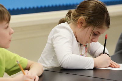 "Erica Miller @togianphoto - The Saratogian, Third graders during their ""Flow of Energy"" science lab taught by Jane Ann McCullough on Wednesday, Jan. 15th 2014. Mia Grolley writes answers down on her paper during class at Lake Ave Elementary School."