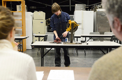 Erica Miller @togianphotog - The Saratogian:   At the BOCES school on Henning Road in Saratoga Springs, Ballston Spa Junior James Sanders, 16 years old, demonstrated how to take apart brakes during the Skills USA competition. He demonstrated in front of volunteer Sarah Blanford and BOCES teacher Doug Fleischut.
