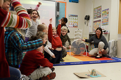 "Erica Miller @togianphotog - The Saratogian:  On Thursday morning, February 27th, 2014, kindergartners in Mrs. Allison Girard's classroom (maternity substitute teacher) at Lake Ave Elementary, students worked on building homes with play dough, sticks and glue. The class is the only pilot school in NYS for the pre-engineering program Project Lead the Way. The class read the ""three little pigs"" and tried to build their own houses to test against a fan. Girard turned on the fan to test one groups house, as the students cheer in excitement."
