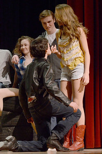 "Erica Miller @togianphotog - The Saratogian:   The Saratoga Spring High School held a dress rehearsal for their upcoming play Footloose. Lead actor playing Ariel played by Izzi Cavotta and her ""boyfriend"" Chuck played by Liam McKenna on stage during rehearsal."