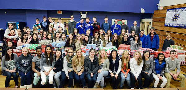 Erica Miller @togianphotog- The Saratogian.     The Saratoga Springs High School National Honor Society wrapped over a thousand presents Wednesday night. The Be A Santa to a Senior program, their 10th year, is put together through the Home Instead Senior Care. All gifts were requested through the seniors on a Senior Tree ornament.  SAR-l-SantaSenior9