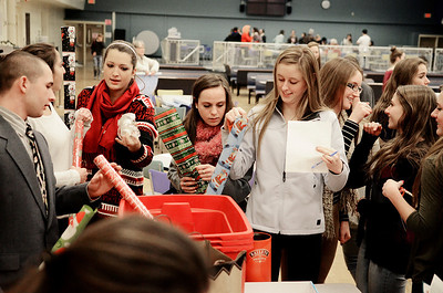 Erica Miller @togianphotog- The Saratogian.     The Saratoga Springs High School National Honor Society wrapped over a thousand presents Wednesday night. The Be A Santa to a Senior program, their 10th year, is put together through the Home Instead Senior Care. All gifts were requested through the seniors on a Senior Tree ornament.  SAR-l-SantaSenior1