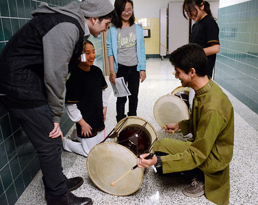 Ed Burke - The Saratogian 03/22/14 Acadia Middle School student Yaurie Hwang smiles as Shen senior Mateeb Qureshin, dressed in a Pakistani shirt plays her Korean drum Saturday during Shensational Global Expo 2014 at Shenendehowa West High School. The annual event celebrates the cultural diversity reflected in the local community.