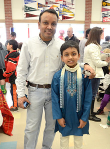 Ed Burke - The Saratogian 03/22/14 Wearing a shirt reflecting his Indian heritage, Shatekon Elementary student Kartick Ragavan stands with his father Ragavan Vellayappan during Shensational Global Expo 2014 at Shenendehowa West High School. The annual event celebrates the cultural diversity reflected in the local community.
