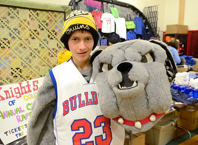 "Ed Burke - The Saratogian 03/07/14 Freshman Ben ""Bones"" Kinne lets the dog out as South Glens Falls High School Bulldogs kick off their 24 hour Marathon Dance Friday night. Funds raised from the event, which began in 1977, wills be distributed between 39 needy individuals, families and organizations. Kinne has dressed as top dog since he was in 5th grade."