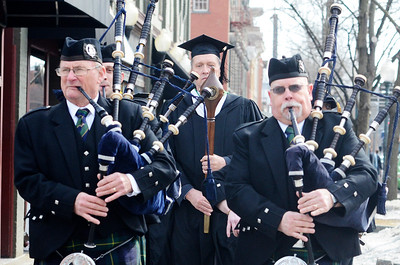 "Erica Miller @togianphotog - The Saratogian:  At the Saratoga Springs City Hall's Music Hall, robbing took place before the procession down Broadway for the inauguration of Merodie A. Hancock, Ph.D., as the fourth President of Empire State College. The 97th old Schenectady Pipe Band performed ""When the Battle O're"" and ""Green Hills of Tyroll"" was they led the procession. Tom McElroy, '96, was the mace bearer leading the parade."