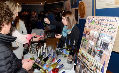 Ed Burke - The Saratogian 03/28/14 Kristina Knipes of Adirondack Winery serves wine during Friday's Night at The Brewseum fundraiser at the New York State Military Museum. The event was sponsored by Friends of the New York State Museum and the Saratoga Lions Club.