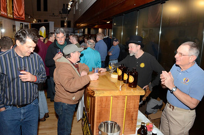 Ed Burke - The Saratogian 03/28/14 David Bruce, owner of Paradox Brewery, tophat, gets help serving from Lion's Club member Norm Smith during Friday's Night at The Brewseum fundraiser at the New York State Military Museum. The event was sponsored by Friends of the New York State Museum and the Saratoga Lions Club. Bruce is a member of the Schroon Lake Lion's Club.