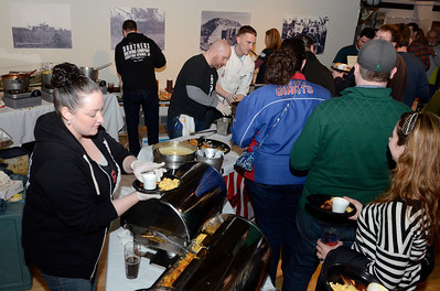 Ed Burke - The Saratogian 03/28/14 Alyssa Stokes works the mac'n' cheese station for Druthers Brewing Co. during Friday's Night at The Brewseum fundraiser at the New York State Military Museum. The event was sponsored by Friends of the New York State Museum and the Saratoga Lions Club. Bruce is a member of the Schroon Lake Lion's Club.