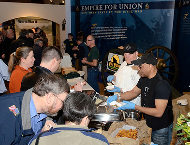 Ed Burke - The Saratogian 03/28/14 Jasper Alexander, facing, and Jaime Diaz of Hattie's dish out grits and pulled pork during Friday's Night at The Brewseum fundraiser. The event was sponsored by Friends of the New York State Museum and the Saratoga Lions Club.
