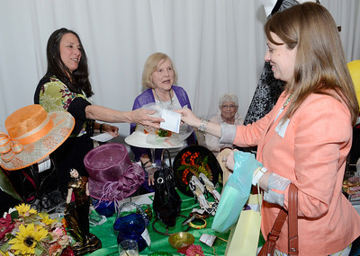 Volunteers at Treasures make a sale during Thursday's Just for Women event at the Saratoga Springs City Center. Volunteers from left are Lind Dziengielewski, Anne Hunscher and Fran Barron. Treasures is the thrift shop operated by the hospital's foundation.