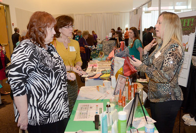 Ed Burke - The Saratogian BJ Pierce  of Arbonne shows skin care products to Ann Carroll, left, and Susan Axelrod at the Just for Women event Thursday.